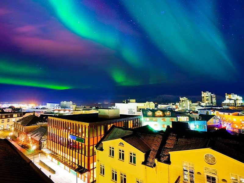 The Northern Lights hang over Reykjavik