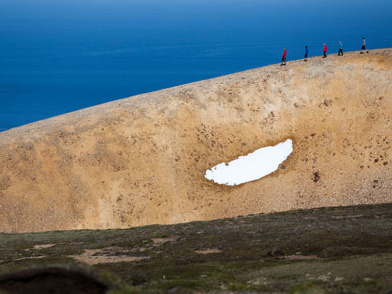 hikers on the trail in the Islandic mountains