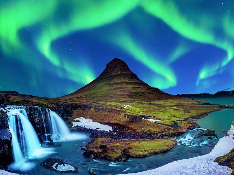 Northern lights embraces a mountain