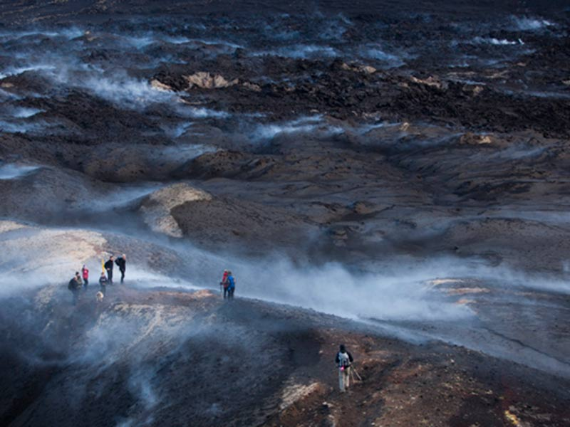 A group of people hiking on an Iceland Volcano