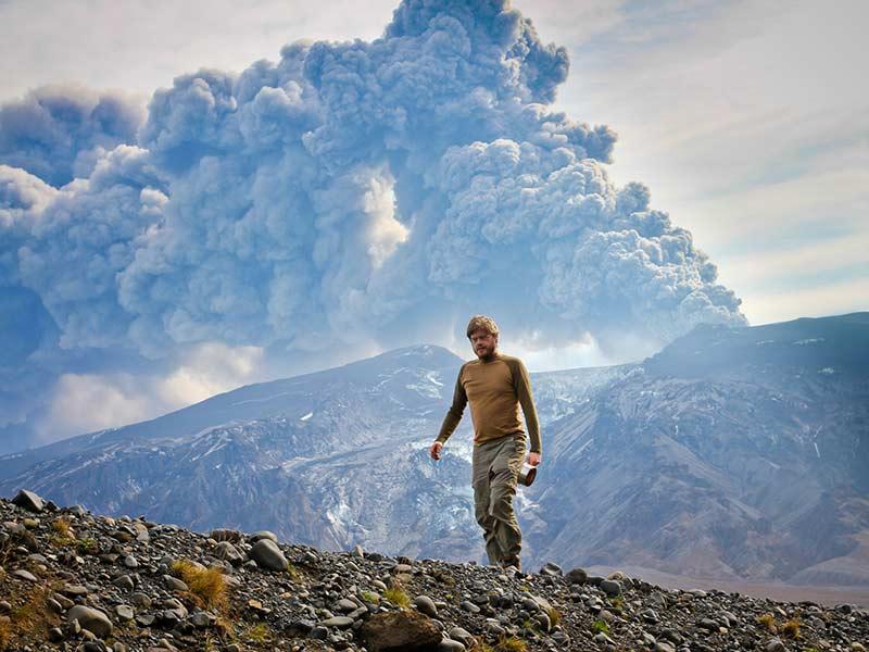 Man walking close to Eyjafjallajokull glacier