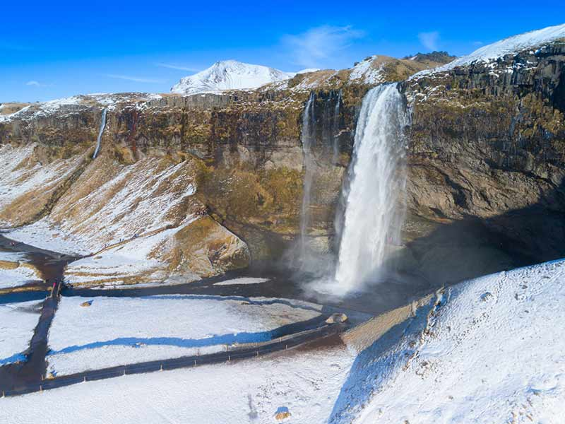 Seljalandfoss Waterfall in Iceland on a sunny day