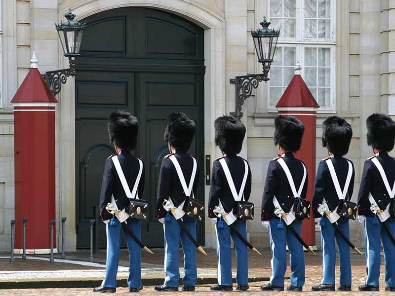 Guards standing in front of Amalienborg Palace in Copenhagen, Denmark.