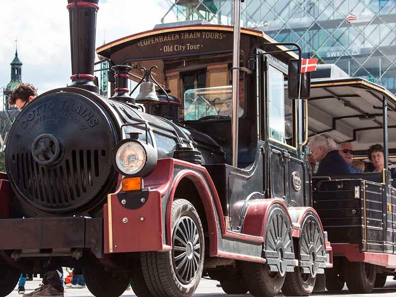 Copenhagen's City Train driving around in the old streets of Copenhagen