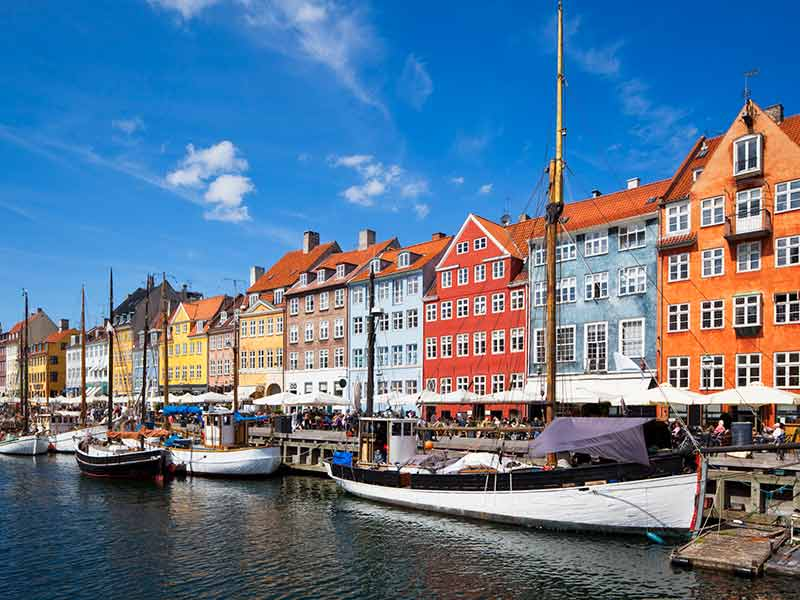 Nyhavn in Copenhagen is lined by brightly coloured townhouses and bars, cafes and restaurants.