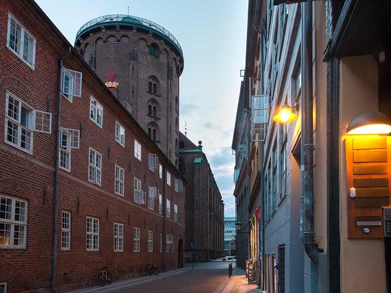 Empty street and Round Tower, Rundetaarn, in the morning, Copenhagen, capital of Denmark