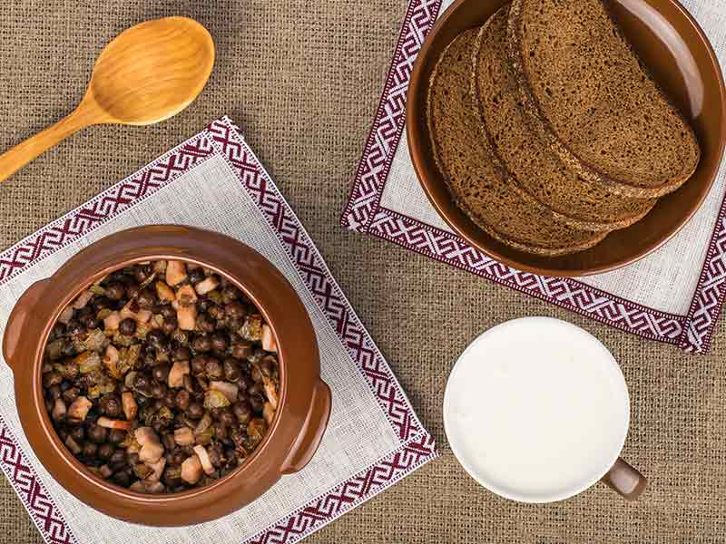 Latvian traditional dish - gray peas with bacon, rye bread and kefir