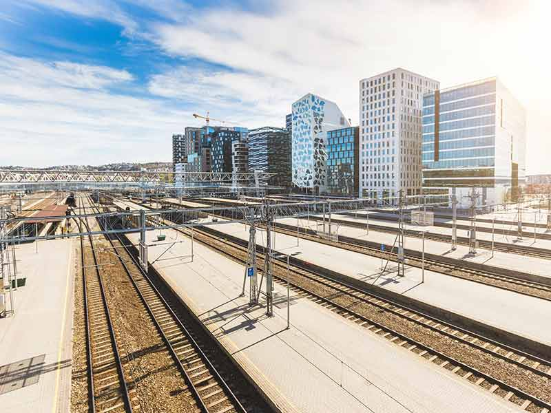 Oslo view with train station and modern buildings on background
