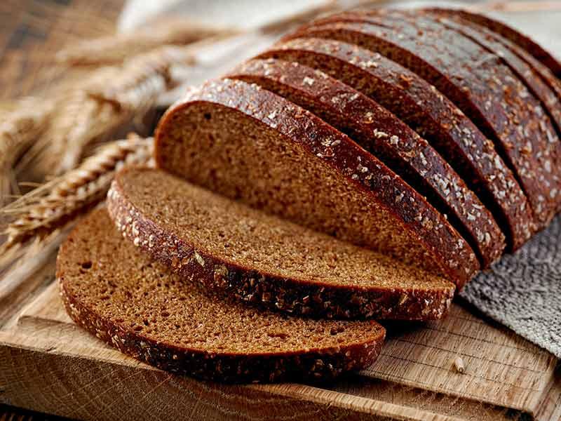 fresh rye bread on wooden cutting board in Riga