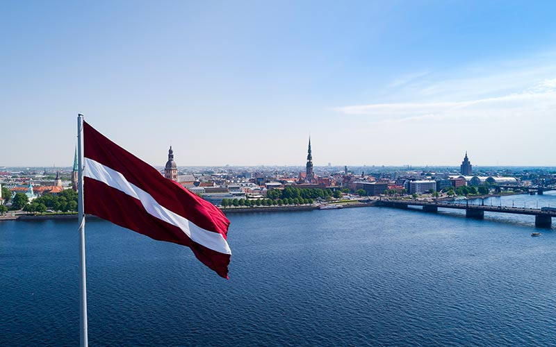 Panorama of Riga city with a big Latvian flag in foreground