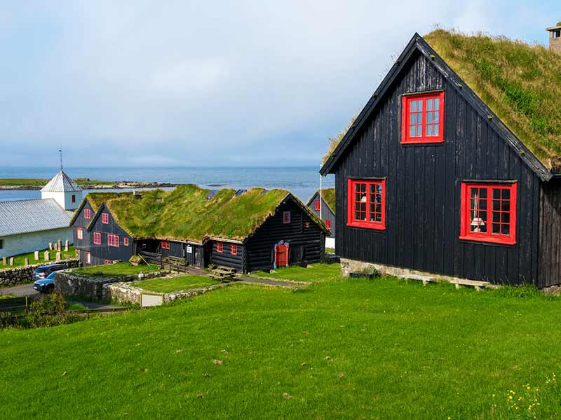Traditional Faroese wooden houses in Kirkjubour Village, Faroese island of Streymoy